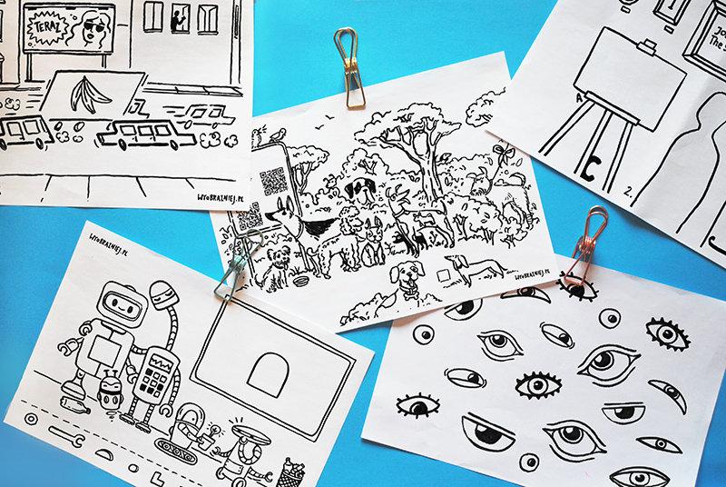 Na zdjęciu widać wydrukowany zestaw plansz z czarno-białymi ilustracjami.